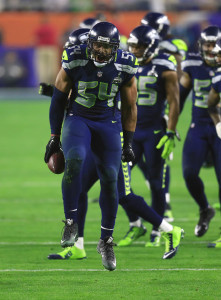 Feb 1, 2015; Glendale, AZ, USA; Seattle Seahawks middle linebacker Bobby Wagner (54) celebrates after his interception against the New England Patriots during the third quarter in Super Bowl XLIX at University of Phoenix Stadium. Mandatory Credit: Andrew Weber-USA TODAY Sports