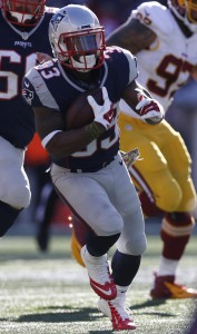 Nov 8, 2015; Foxborough, MA, USA; New England Patriots running back Dion Lewis (33) carries the ball during the first quarter against the Washington Redskins at Gillette Stadium. Mandatory Credit: Greg M. Cooper-USA TODAY Sports